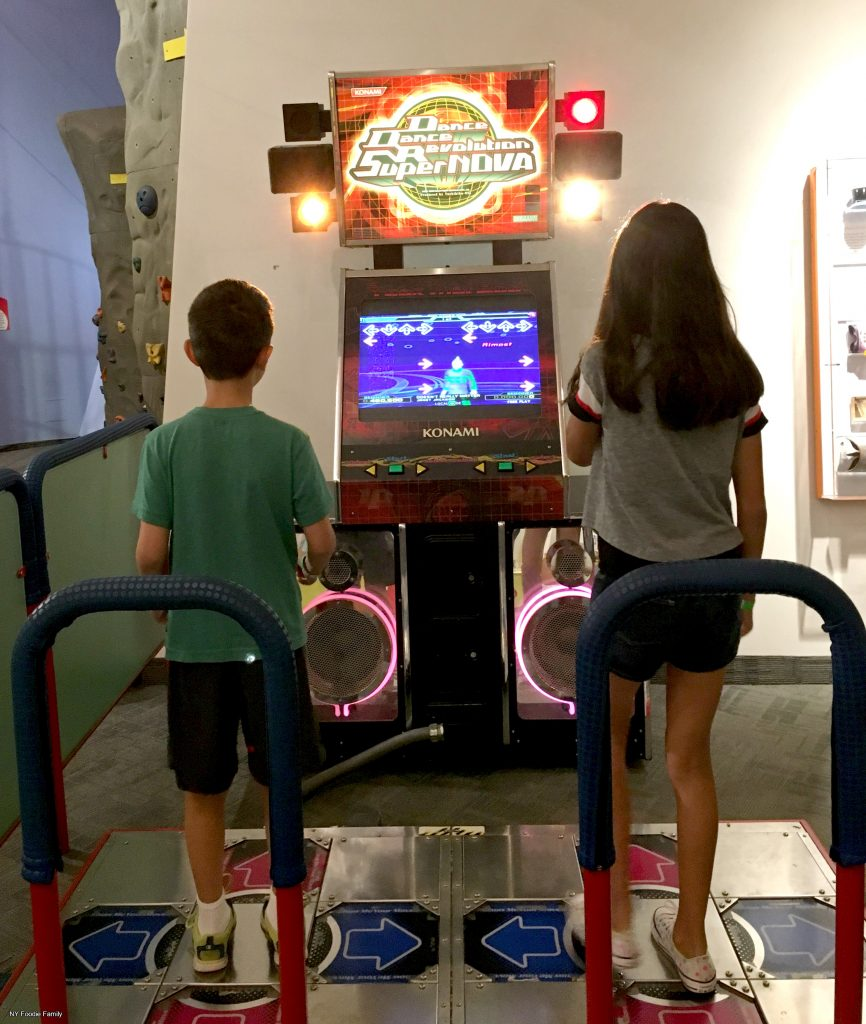 The kids playing Dance Dance Revolution at the Strong Museum of Play.